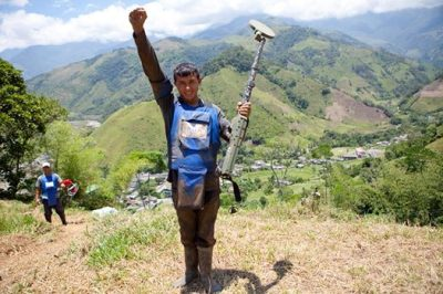 Deminer Jorge Daza celebrating the first mine found by HALO in Colombia last September (2013)