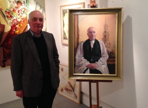 Bill posing with his portrait at the Curwen Gallery